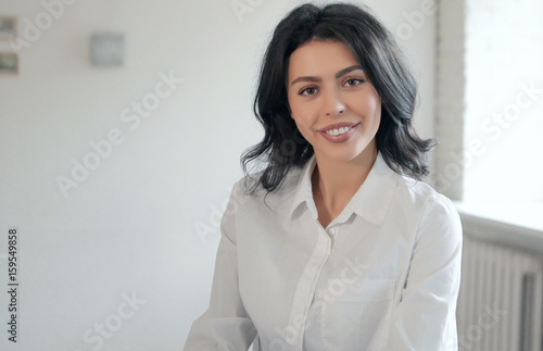 Young Beautiful White Female Lawyer In A White Blouse Smiles At The