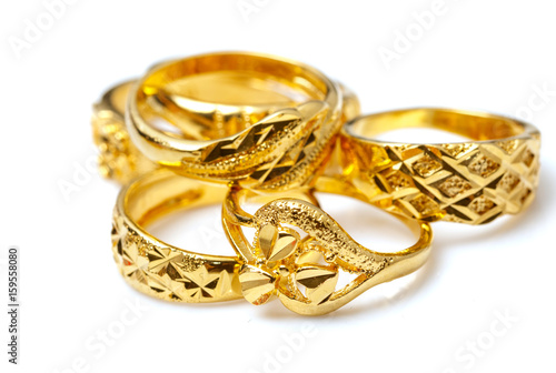 Group of many design gold rings on white background