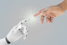 Human And Robot Hands Reaching...
