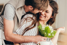 Young Casual Couple Embracing ...