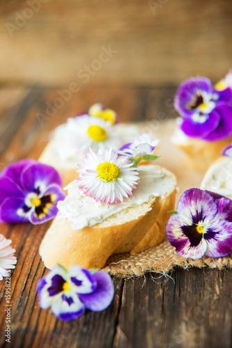 Spoed Foto op Canvas Klaar gerecht Sandwich with herb and edible flowers butter on marble cutting board. Healthy food.