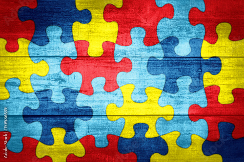 Fotomural Puzzle Pieces in Autism Awareness Colors Background Illustration