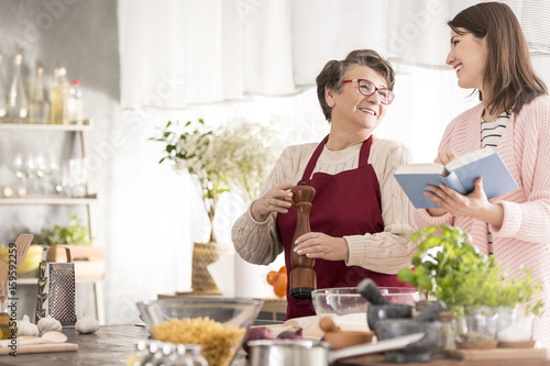 Foto op Plexiglas Koken Woman reading grandmother recipes
