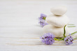 Stones and twigs with lavender flowers on wooden table