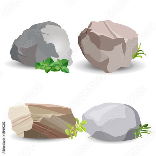 Photo Four boulder stones with green grass isolated on white