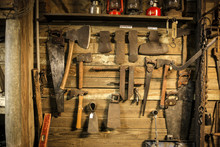 Old Tools Hanging On A Wall In...
