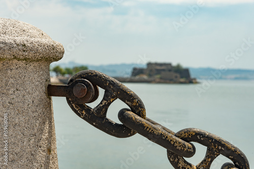 Strong metal weathered chain link barrier with a shallow depth of field and an u Poster