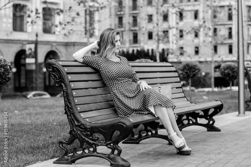 Fotografie, Obraz  A sad and lonely girl in a big city
