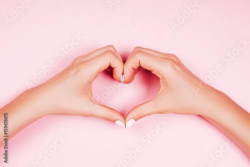 Staande foto Manicure Woman's hand making heart