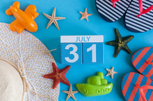 July 31st. Image Of July 31 Calendar With Summer Beach Accessories And Traveler Outfit On Background. Summer Day, Vacation Concept