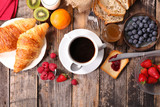 Fototapeta Coffie - breakfast with coffee,croissant and fruits