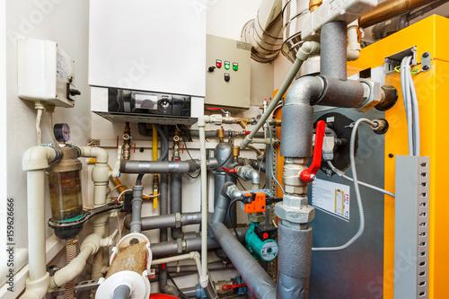 Household boiler room with gas boiler, barrel; Valves; Sensors and a ...