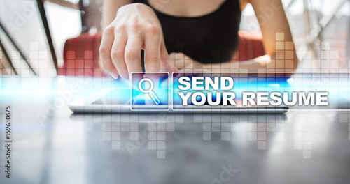 Woman using tablet pc and selecting send your resume. - Buy this ...