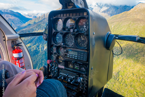 Photo  SOUTH ISLAND, NEW ZEALAND - MAY 21, 2017: Pilot using command cabin of the helic