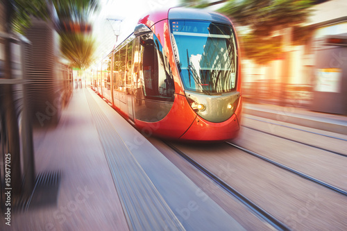 Photo  a fast moving tram in the streets of casablanca