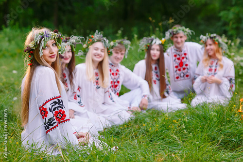 midsummer group of young people of slavic appearance are sitting
