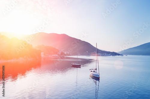 Obrazy na płótnie Canvas Two yachts at sunset
