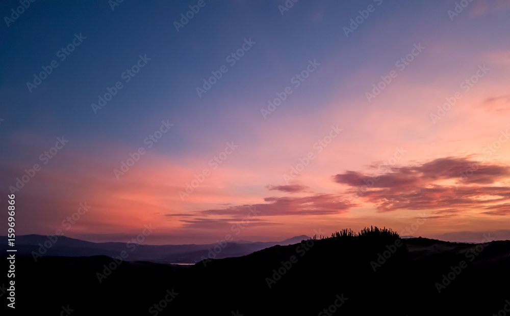Fototapety, obrazy: silhouette landscape under sunset sky in spring with clouds in the background, spring time at dusk