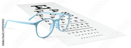 blue eyeglasses on visual test chart isolated on white. Eyesight concept