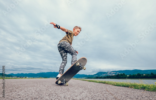 Boy makes a trick with skateboard