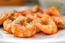 Fried Tiger Prawns With Herbs And Spices On A White Plate.