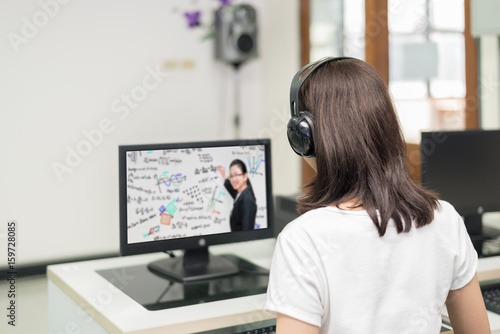 Asian woman student video conference e-learning with teacher on computer in IT room at university. E-learning ,online ,education concept.