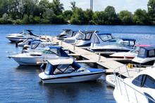 Docked Boat. Boat Mooring In The River Port
