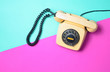 canvas print picture - Vintage phone on a blue pink neon surface. Top view. Pop colors. Communication 80s. Flat lay.