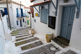 Fototapeta Na drzwi - Narrow street with stairs and traditional houses in the old town of Koroni in Peloponnese, Greece