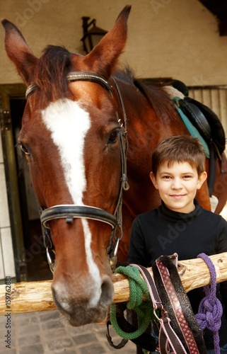 Little boy with horse Wall mural