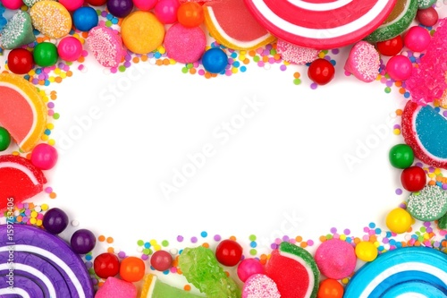 Frame of an assortment of colorful candies against a white ...