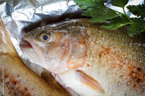 Fotobehang Amber trout with spices, prepared for baking in foil