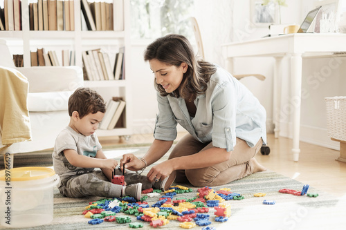 Mother playing with son (2-3)