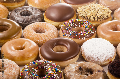 Photo  Background of Assorted Donuts (Doughnuts) of Various Flavors