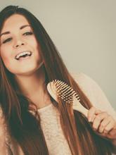 Happy Woman Brushing Her Hair