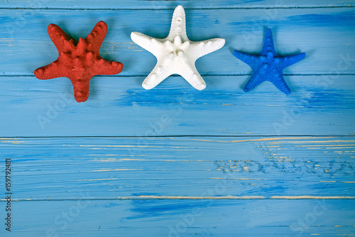 Fotografie, Obraz  red white and blue starfish on nautical blue rustic wood