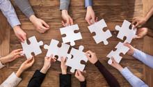 Businesspeople Hand Solving Ji...