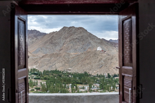Top View of Leh from open wooden window of the light room in Shanti Stupa, Leh Ladakh, Kashmir. North of India. Asia Travel
