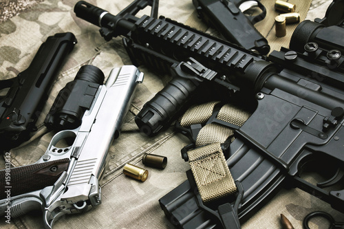 Cuadros en Lienzo Weapons and military equipment for army, Assault rifle gun (M4A1) and pistol on camouflage background