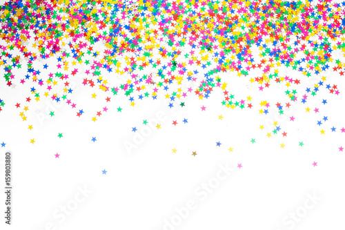 Confetti colored stars. White background. Frame of confetti.