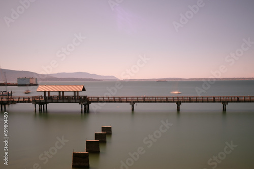Long exposure of a long walkway over the water