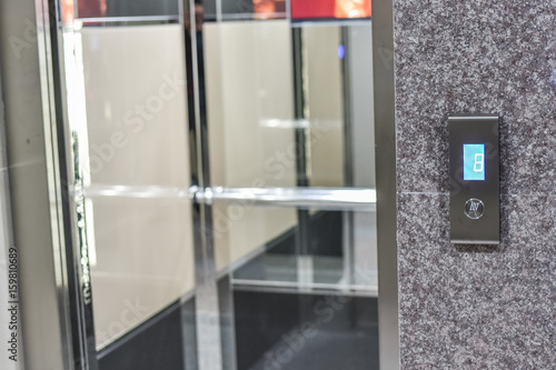 Foto op Aluminium Luchthaven Elevator interior with modern design and pressing elevator buttons