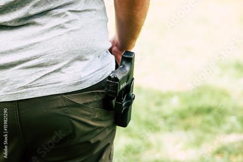 Fotografía  Pistol in the holster