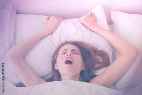 Beautiful woman getting sexual satisfaction in bed Wallpaper Mural