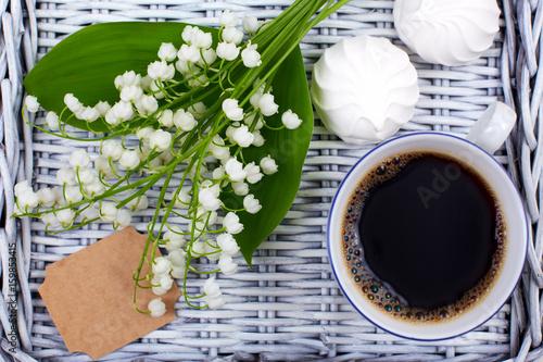 Poster Muguet de mai A mug of coffee, marshmallows and flowers lie on a blue wooden tray. Healthy breakfast