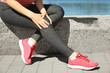 Young sporty woman suffering from pain in leg outdoors