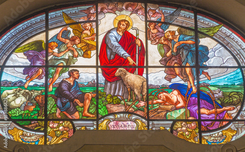TURIN, ITALY - MARCH 13, 2017: The stained glass of Good Shepherd in Church Chiesa di Santo Tommaso by unknown artist from year 1928 Slika na platnu