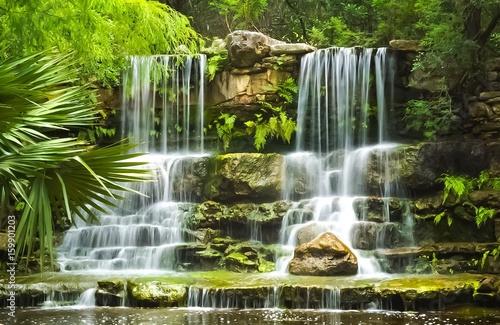 The waterfalls in Prehistoric Park in Zilker Botanical Garden in Austin Texas - 159901203