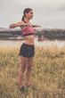 Woman stretching and exercising outdoor.