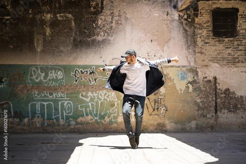 Hip hop dancer performing outdoors Wallpaper Mural